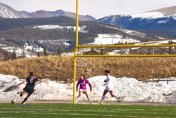 Summit freshman goalkeeper Anna Tomlinson (0) defends against a shot from Eagle Valley's Hana Berger (6) during a home varsity soccer game on March 21. The Tigers lost, 1-3.