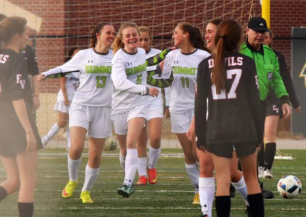 The Summit High girls soccer team celebrates after junior Shannon Hogeman (11) scores the team's lone goal against Eagle Valley at home on March 21. The Tigers lost, 1-3.