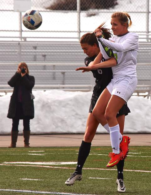 Summit sophomore Sydney Kersteins (7) bumps up against Eagle Valley's Hana Berge (6) after a header in the second half of a home varsity soccer game on March 21. The Tigers lost, 1-3.
