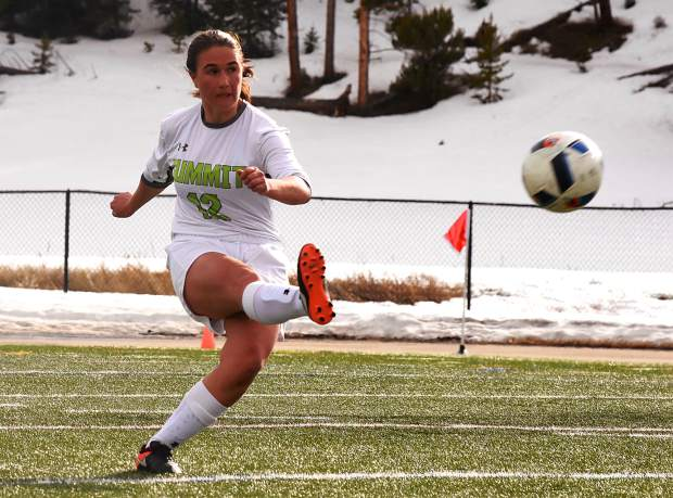 Summit sophomore Grace Karoly (12) boots the ball downfield on a free kick during a home varsity soccer game against Eagle Valley on March 21. The Tigers lost, 1-3.