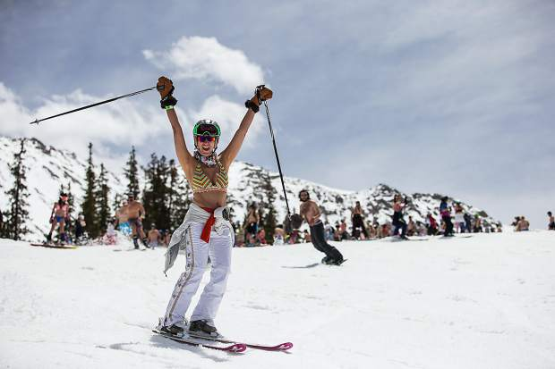 A skier celebrates May skiing the Colorado way: with a swimsuit parade at Arapahoe Basin on May 21 in 2016. At nine months from October to June, the ski area regularly has one of the longest ski seasons in North America.