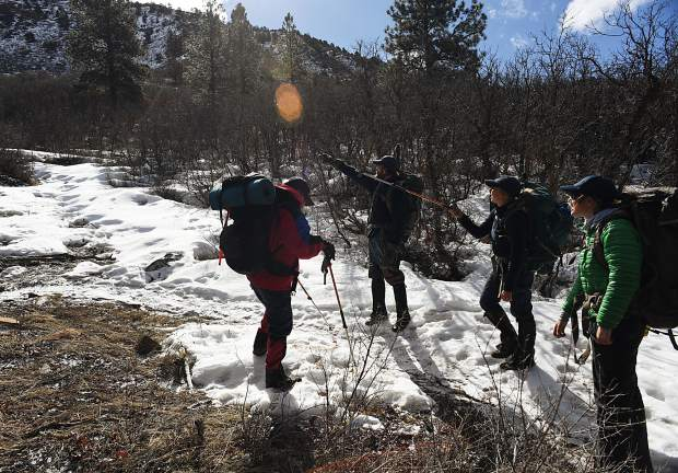 DURANGO, CO -MARCH 06: Colorado Parks & Wildlife researchers plan their hike, up Raider Ridge in Durango, to a bear den to study bears in an area near populated areas, March 06, 2017. The researcher are working on a five-year study of bear behavior and bear and human interactions around Durango. (Photo by RJ Sangosti/The Denver Post)