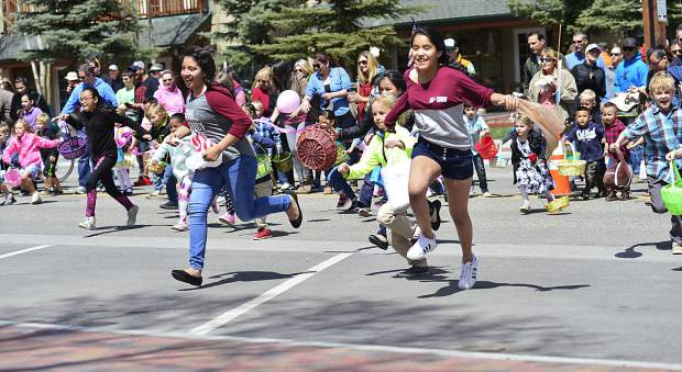 With the city putting out more than 5,000 plastic eggs, including some filled with inspirational notes in addition to candy, children race out to collect them at the start of the 2017 Easter egg hunt Sunday in Frisco.