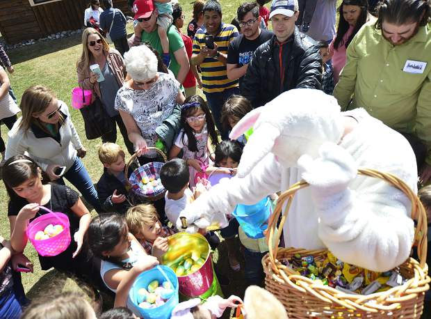 The Easter bunny passes out candy and eggs after all the eggs had been rounded up Sunday during the 2017 Easter egg hunt in Frisco.