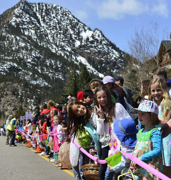 Children line up on Main Street for the start of the annual Easter Egg hunt Sunday in Frisco. The hunt began at noon sharpe, and the children collected all of the 5,000 eggs put out by the city in a matter of minutes.