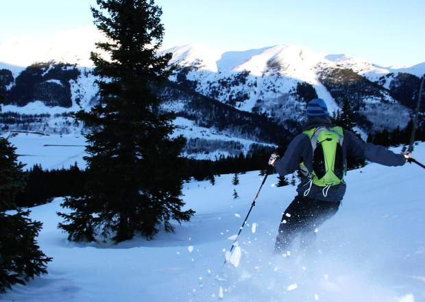 Eric Thomson of Boulder charges downhill during an early morning backcountry touring session at Mayflower Gulch, found about 5 miles south of Copper Mountain. The area is popular with backcountry travelers and prime for touring until mid-May, when other, higher terrain is safer for travel.