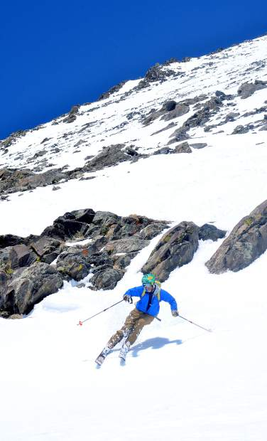 Fritz Sperry takes a few final turns in early May on the last section of the Cristo Couloir, a popular route from the summit of Quandary Peak (14,265 feet) to a tarn nearly 3,200 feet below. Spring skiing on 14ers and other high-altitude peaks is safe on a day-to-day basis, depending on conditions and recent snowfall activity.