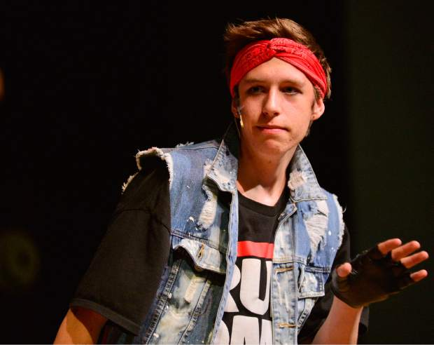 "Nash LaFrankie performs Tuesday during a rehearsal for Summit High School's spring musical ""We Will Rock You"" at the school."