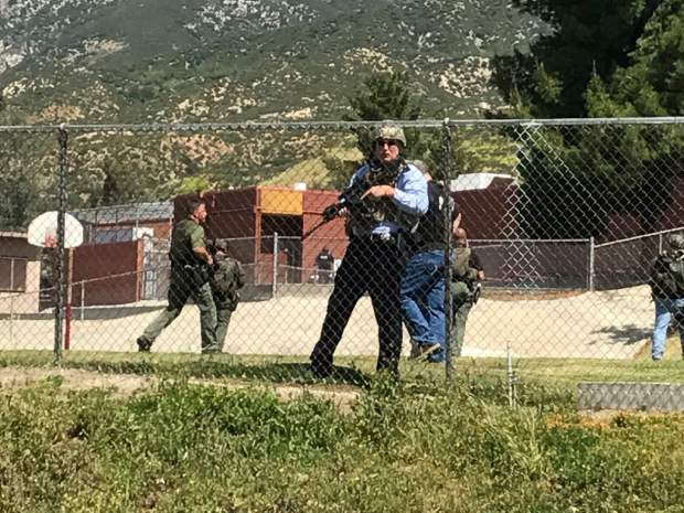 Emergency personnel respond to a shooting inside North Park School Elementary School on Monday, April 10, 2017, in San Bernardino, Calif. (Rick Sforza/Los Angeles Daily News via AP)