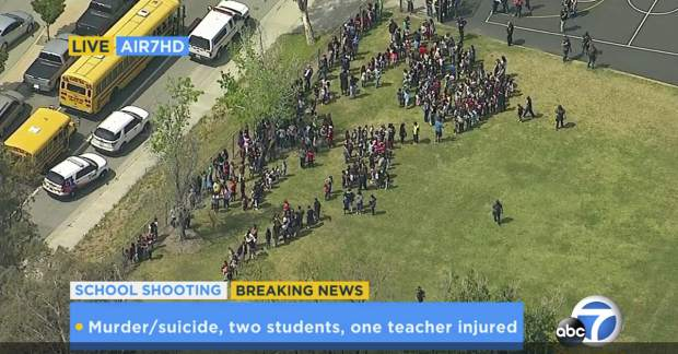 In this frame from video provided by KABC-TV, faculty and students evacuate North Park School Elementary School as emergency personnel respond to a shooting inside on Monday, April 10, 2017, in San Bernardino, Calif. (KABC-TV via AP)