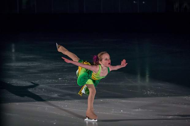 Danielle Weisberg extends her arms and leg as she skates on one foot March 25 for the Stephen C. West Ice Arena's spring skating exhibition