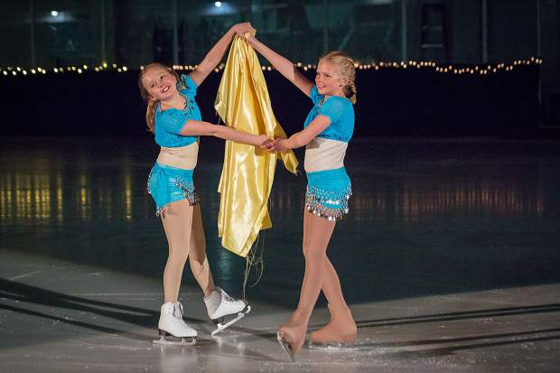Isabelle Esposito and Taylor Perry take the spotlight March 25 during the Stephen C. West Ice Arena's spring skating exhibition