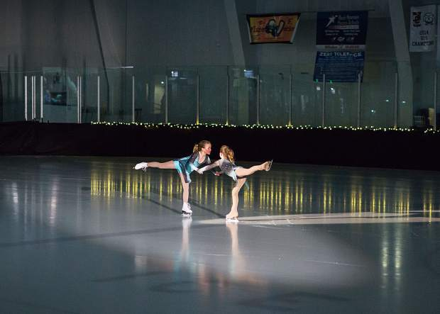 Danielle Weisberg and Madison Haser skate together March 25 during the Stephen C. West Ice Arena's spring skating exhibition