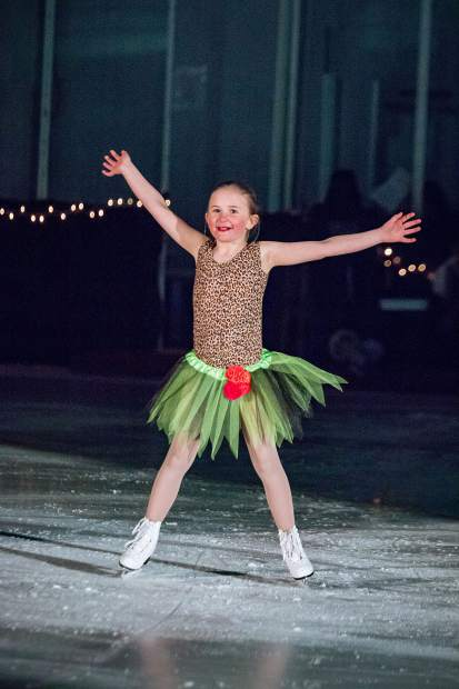 Madison Haser raises her arms in the air as she performs March 25 for the Stephen C. West Ice Arena's spring skating exhibition