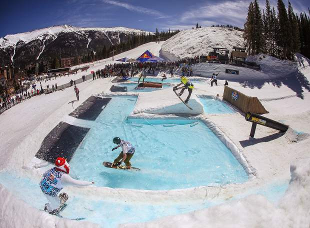 Skiers and snowboarders get rowdy in the pool under bluebird skies at the 2017 Red Bull Slopesoakers pond-skimming rail jam at Copper Mountain.