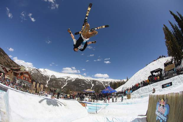 A skier lays out a fat backflip over the main pond feature during the 2017 Red Bull Slopesoakers pond-skimming rail jam on April 15 at Copper Mountain.