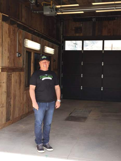 Owner Mark Smith stands outside what will be the drive-thru marijuana dispensary in the state.