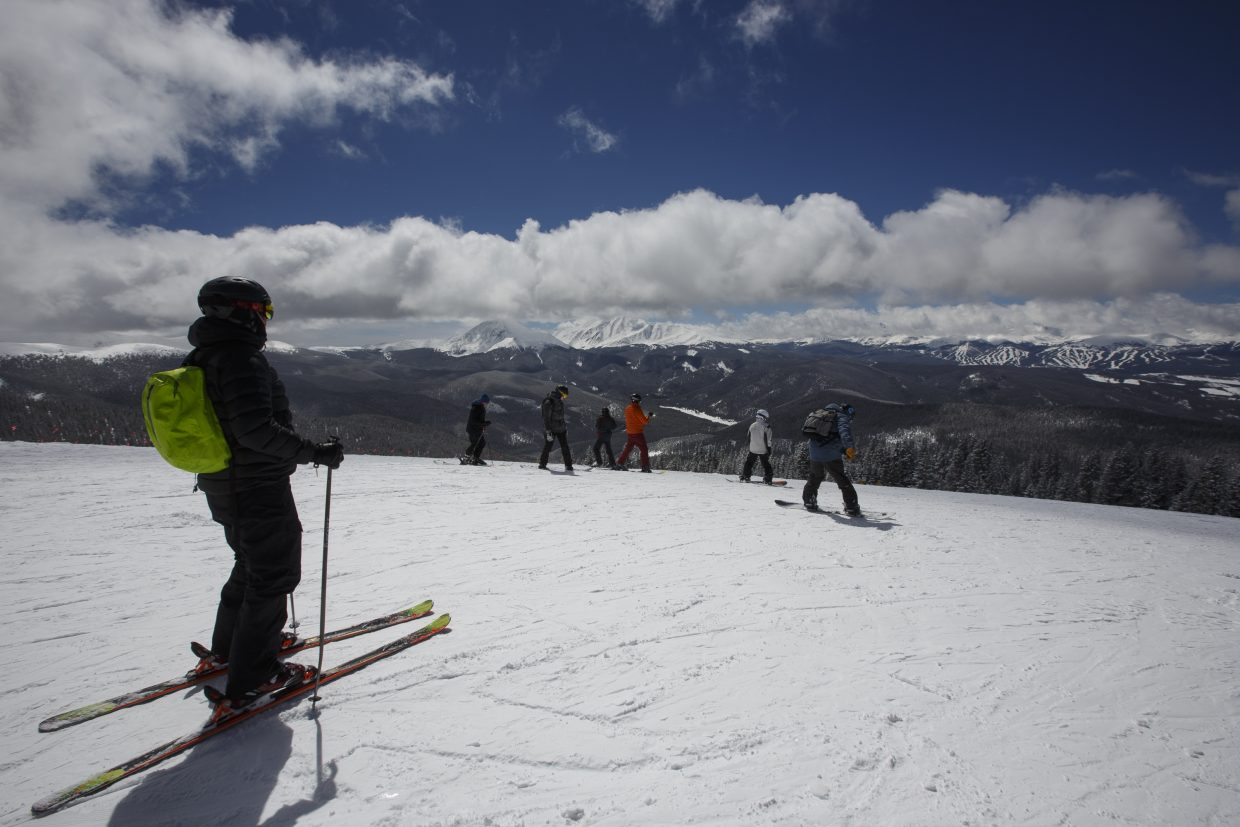 Skiers stop at the Outback at Keystone Resort to take in the views in late March. The Summit ski area's estimated 1.2 million visits contributes to the county's total of about 4.3 million per year.