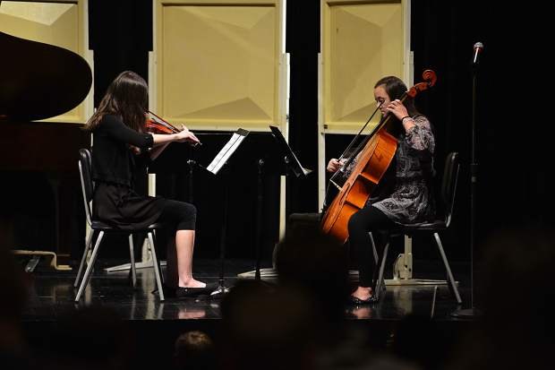 """With the help of Maclean Donovan on violin, Abigail Wineland, right, performs her original composition, """"Dance of the Dragonfly,"""" during the third annual Young Composers Competition Concert on Monday at Summit Middle School in Frisco."""