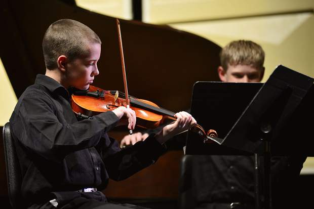 """With Malachi Ryan, right, Isabella Huhn and Isaac Webster, both not shown, Caleb Arthurholt performs his original composition, """"Quartet for Violins,"""" during the third annual Young Composers Competition Concert on Monday at Summit Middle School in Frisco."""