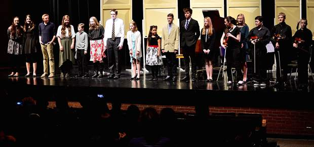 From left, Abigail Wineland, Maclean Donovan, Corey Johnson, Lily Windsor, Ethan Windsor, Sophia Elsass, Zachary Elass, Charlotte Hudnut, Ashley Luna, Simeon Ryan, Grant Morgan, Kayla Pazin, Abigail Schmidt, Isabella Huhn, Isaac Webster, Malachi Ryan and Caleb Arthurholt stand together on stage at the conclusion of the Young Composers Competition Concert on Monday at Summit Middle School in Frisco.