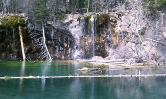 Hanging Lake visitors increase each year, straining the trail and parking lot and endangering the lake itself.