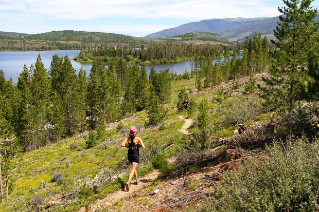 A competitor in the Frisco Traithlon runs down singletrack during the final leg of the race in 2015. Local trainers recommend a mix of dryland and gym training before the start of trail running and race season.