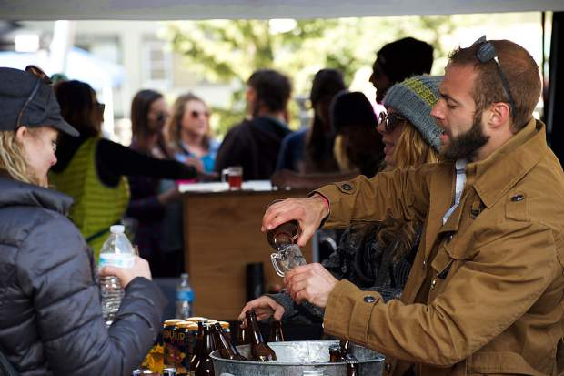 Vendors pour beers for festivalgoers April 7 in Breckenridge for the Spring Beer Festival.