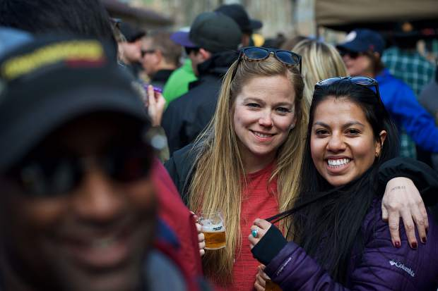 Lisa Monroe of Frisco and Ruth Herrera of Glenwood Springs pose for a photo amid the crowd April 7 at the Spring Beer Festival. Monroe said she was partial to the beer put out by Outer Range Brewery, a new brewery in Frisco.