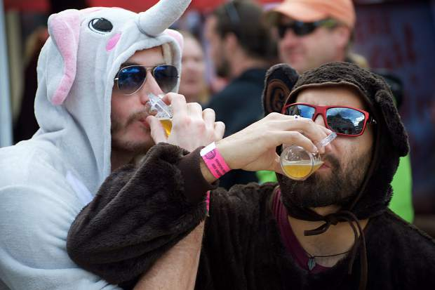 Philip Jones, left, and Aaron Martinez of Houston wrap arms as they enjoy the brews April 7 at the Spring Beer Festival in Breckenridge. Martinez said he especially enjoyed a lemonade cider and a chocolate-flavored stout that were available among more than 150 other kinds of beer at the festival.