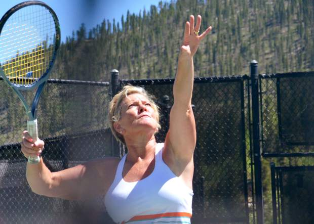 Loras Heck of Kansas City lines up a shot during a drop-in tennis clinic at the Breckenridge tennis courts in July 2016. The rec center hosts clinics for players of all ages, from beginner to expert, and head instructor John O'Connor suggests beginning the season with light exercises and warm-ups.