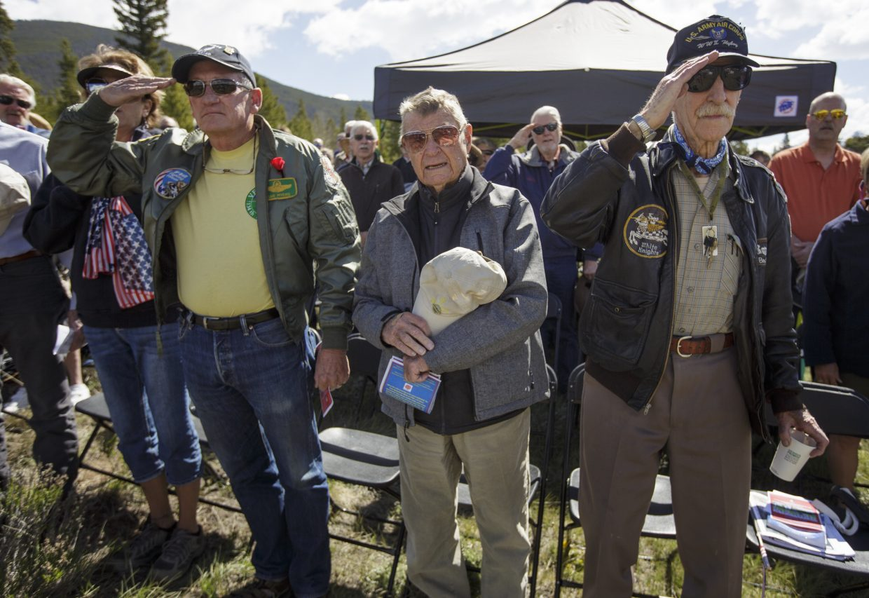 From left in front, U.S. Air Force veteran pilot Dan Myers, Bob Kluge, and World War II veteran fighter pilot Boot Gordon pay tribute to the flag during the annual Memorial Day of Remembrance Ceremony Monday, May 29, 2017, at the Dillon Cemetery in Dillon.