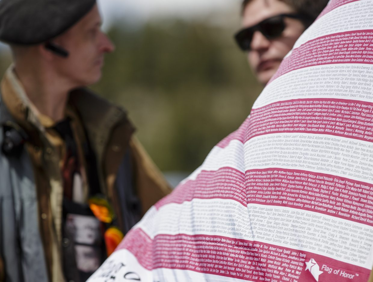 Names of those who died on Sept. 11, 2011 are printed on an American flag, which belongs to Thomas Schmitt, during the annual Memorial Day of Remembrance Ceremony Monday, May 29, 2017, at the Dillon Cemetery in Dillon.