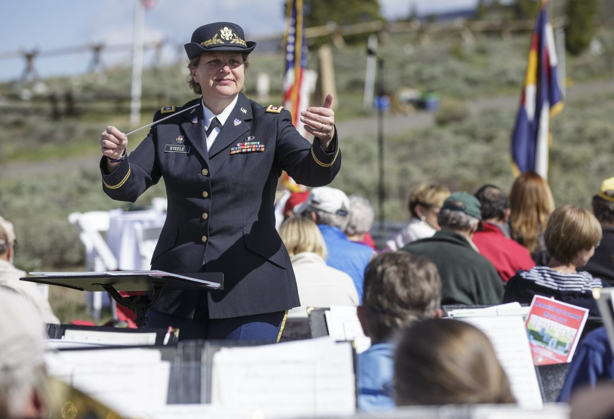 Summit Concert Band director Lt. Colonel Beth Steele orchestrate a song during the annual Memorial Day of Remembrance Ceremony Monday, May 29, 2017, at the Dillon Cemetery in Dillon.