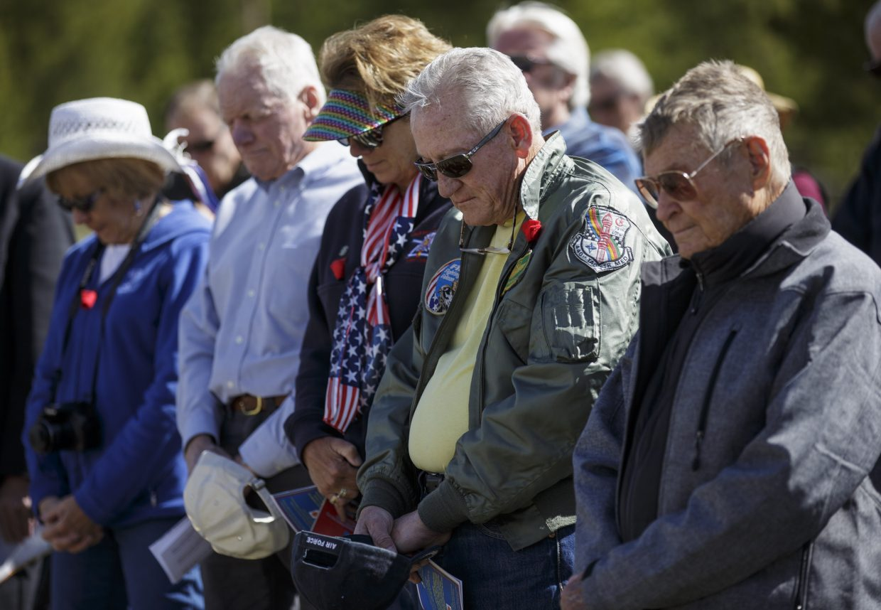 Attendees have a moment of silence during the annual Memorial Day of Remembrance Ceremony Monday, May 29, 2017, at the Dillon Cemetery in Dillon.