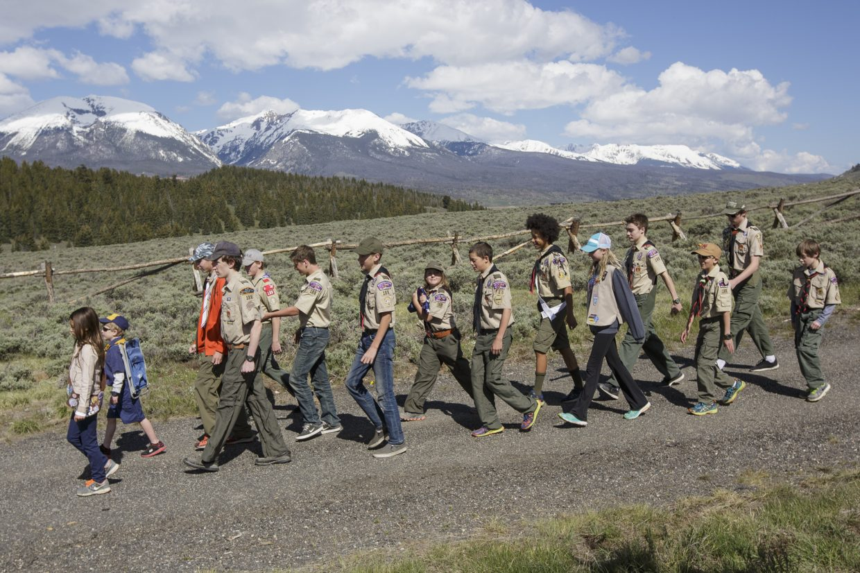 Summit County Boy Scout troop members walk on the road Monday, May 29, 2017, at the Dillon Cemetery in Dillon.