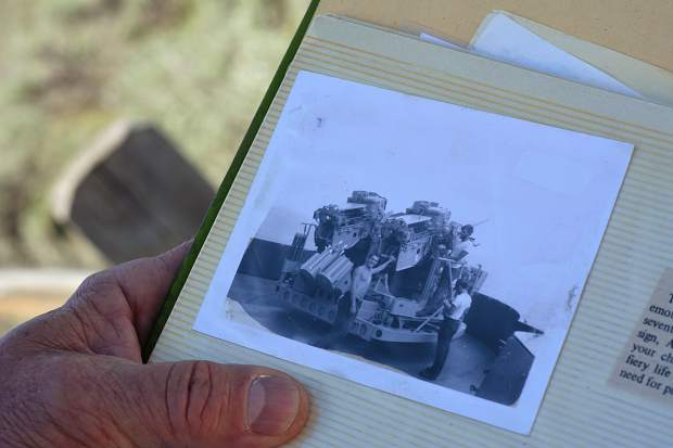 Among the news clippings and keepsakes in military veteran Roman Moore's scrapbook is a washed out photo of him standing in front of a turret from his days in the service in the 1970s.