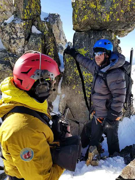 A member of Aspen's mountain rescue team assists a Summit County Rescue Group operation to save California climbers Eric Hall and Thomas Ferrara (not pictured) from near the top of Quandary Peak on Monday morning.