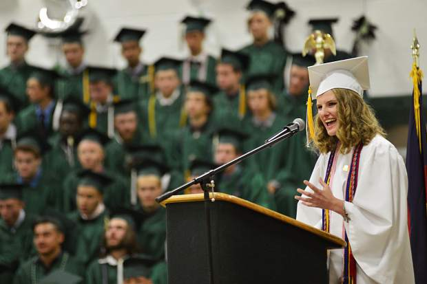 Claire Davidson delivers the student commencement address Saturday during Summit High School's graduation ceremony. Davidson will attend Yale next year on a full scholarship.