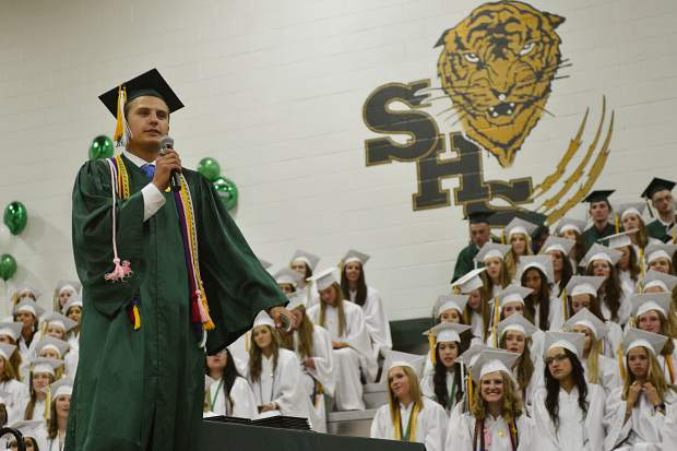 Class President Sam Hull addresses the Class of 2017 at the conclusion of their graduation ceremony Saturday at Summit High School.