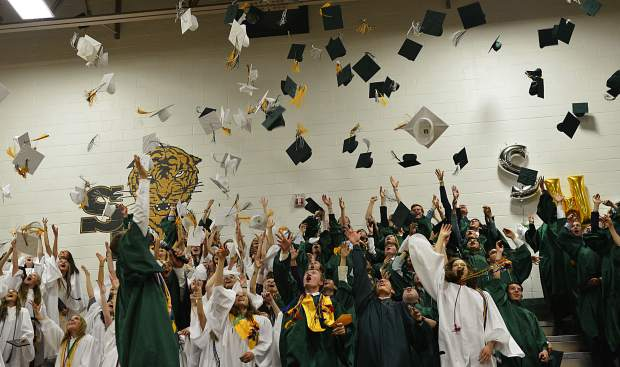 The Class of 2017 throws their caps into the air Saturday during their graduation ceremony at Summit High School. The school graduated 195 students this year.