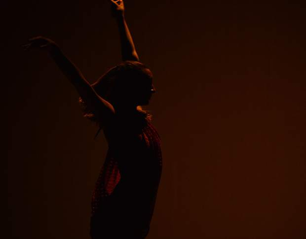 Sylvie Westerhoff is a silhouette as the Summit School of Dance begins a performance titled