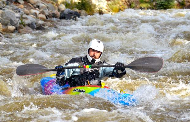 A kayaker aims for an eddy on the banks of Tenmile Creek between Frisco and Copper Mountain during a group paddle trip in 2016. Local kayakers and other experts recommend training now for Summit COunty early (and short) whitewater kayaking season.