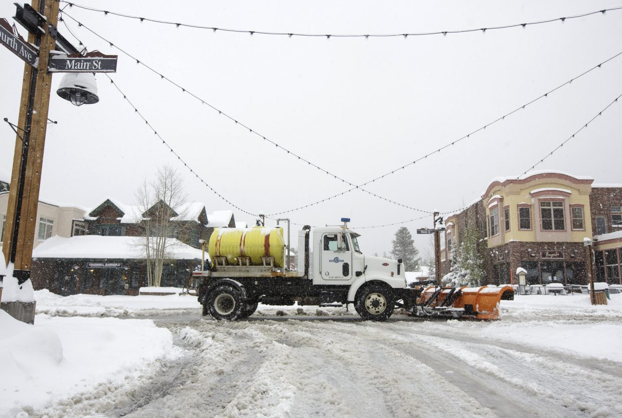 A snow removal machine passes through on Main Street Thursday, May 18, 2017, in Frisco.