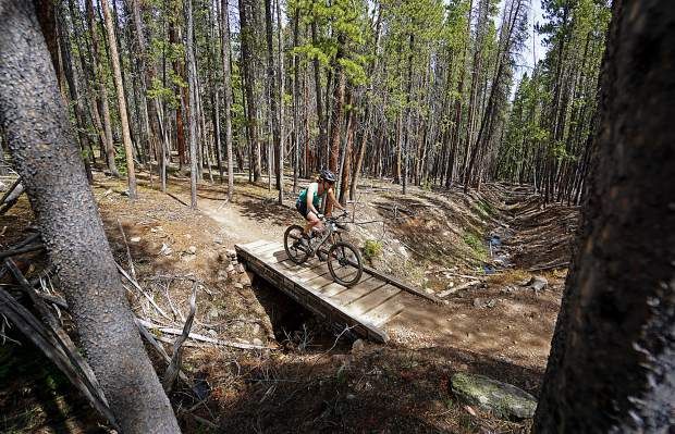 Austyn Williams on the bridges of Middle Flume trail, Breckenridge.