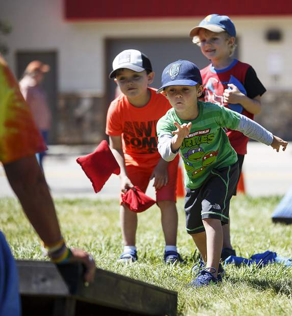 Lake Dillon Preschool summer campers play a round of corn hole during Dillon Farmers Market Friday, June 23, on Buffalo Street in Dillon.