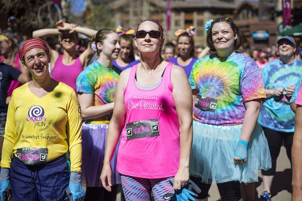 Costumed mud runners get ready to leave the start line for the 2017 Dirty Girl Mud Run at Copper Mountain on June 10. The event drew hundreds of female runners from across the state and globe for a 5K benefit to support Boarding for Breast Cancer, a California nonprofit that pairs breast cancer survivors with snowboarding, skateboarding, surfing and mud running.
