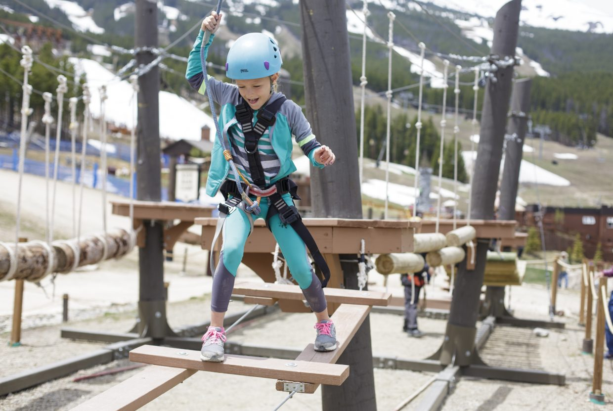Karaline Coker, 8, of Tallahassee, Fla., keeps her balance while crossing