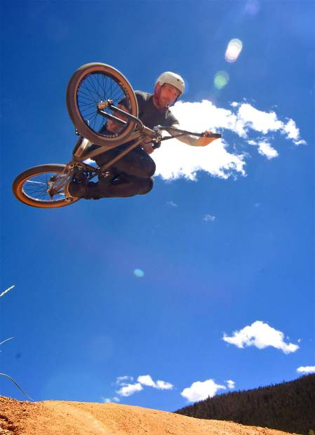 BMXer Nick Smith of Denver lays it out in the Frisco Bike Park jump line during the Frisco Bike Fling jump jam on June 24. More than 20 riders came for the free jump jam and dual-slalom races.