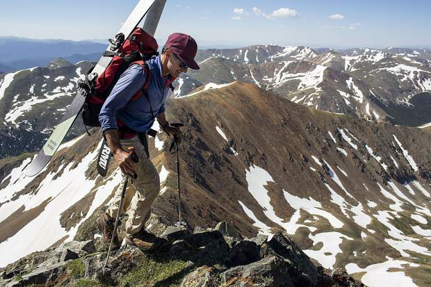 Summit County resident Gary Fondl, 50, hikes towards Grays Peak equipped with skis and boots with his backpack Thursday, June 29, near Montezuma.